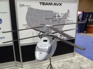 An AVX Future Vertical Lift Model displays on the floor of a preview AHS event