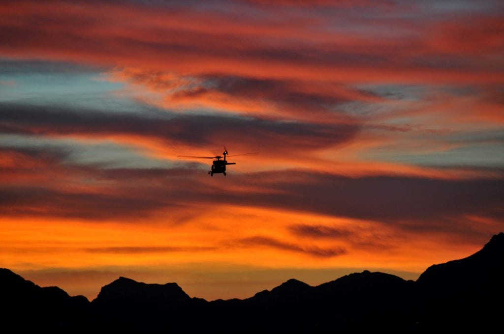 A U.S. Customs and Border Protection UH-60 Black Hawk helicopter takes off from Davis-Monthan Air Force Base, Ariz. during a spectacular sunset March 3, 2014. (U.S. Air National Guard photo by Master Sgt. Andrew J. Moseley/Released)