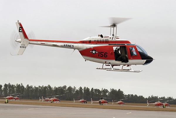 A TH-57 Sea Ranger helicopter taxis down the flight line preparing for a routine training flight at Naval Air Station Whiting Field.