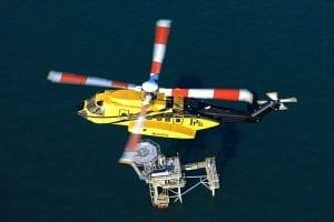 A PHI Sikorsky S-92A cruises over an oil rig in the Gulf of Mexico. Photo courtesy of Lockheed Martin