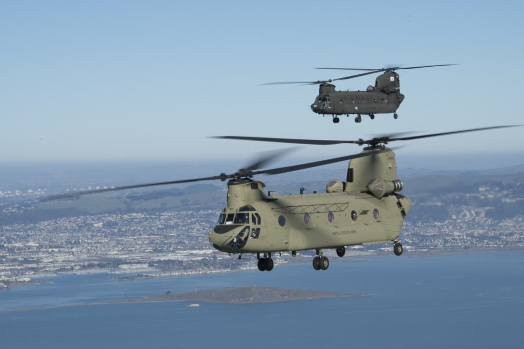 A new California National Guard CH-47F Chinook is tailed by an older CH-47D over the San Francisco Bay on Jan. 9.