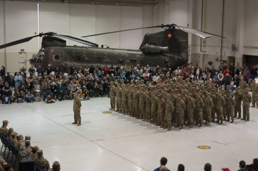 Family and friends gathered with nearly 100 Guardsmen from 2nd General Support Aviation Battalion (GSAB), 149th Aviation Regiment, Oklahoma Army National Guard for a departure ceremony at Muldrow Army Heliport (Army Aviation Support Facility I) in Lexington, Oklahoma, Sunday. The GSAB is deploying three companies to the Middle East. They are comprised of aviators, maintainers and fuel technicians for CH-47 Chinook helicopters in support of Operation Inherent Resolve and Operation Spartan Shield. Having completed pre-mobilization training at Camp Gruber Training Center near Braggs, Oklahoma, the GSAB will move out to Fort Hood, Texas, for additional training before heading overseas. (U.S. Army National Guard Photo by Staff Sgt. Eric McDonough)