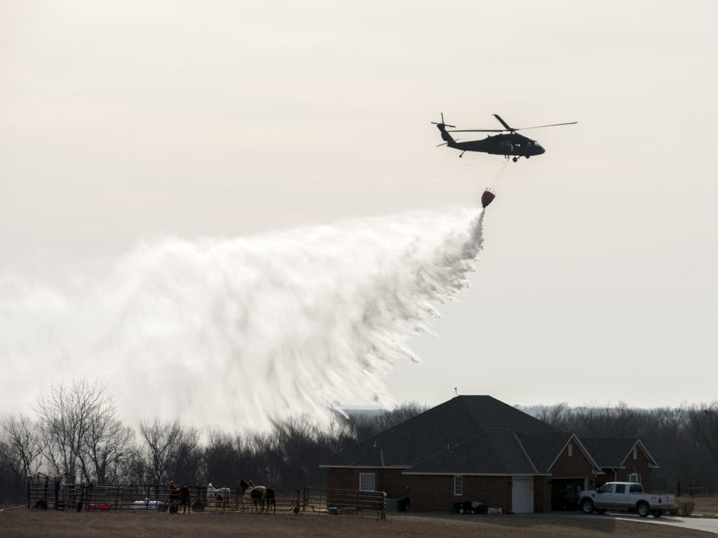 Oklahoma Army National Guard aviators supported local firefighters in Amber, Oklahoma, Wednesday, Feb. 8, 2017. One Blackhawk helicopter with four crew members flying just over two hours, dropped 15 buckets with approximately 9,300 pounds of water on a fire that was located about one mile west of Amber. (U.S. Army National Guard photo by Staff Sgt. Christopher Bruce)