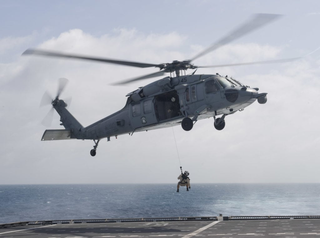 170214-N-WV703-103 SOUTH CHINA SEA (Feb. 14, 2017) Naval Aircrewman (Helicopter) 2nd Class Kevin Brodwater, a search and rescue swimmer assigned to the littoral combat ship USS Coronado (LCS 4), is lowered from an MH-60S Sea Hawk helicopter onto the flight deck during a search and rescue medical evacuation drill. Coronado is a fast and agile warship tailor-made to patrol the region's littorals and work hull-to-hull with partner navies, providing the U.S. 7th Fleet with the flexible capabilities it needs now and in the future. (U.S. Navy photo by Mass Communication Specialist 2nd Class Amy M. Ressler/Released)