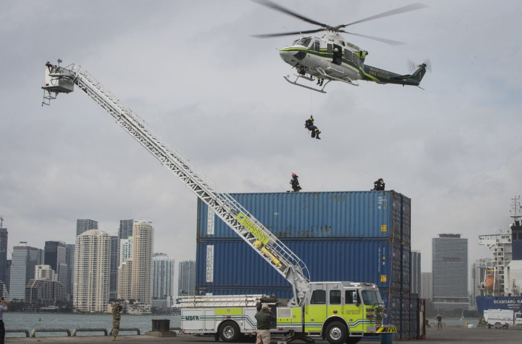 Miami-Dade Fire Rescue emergency responders rappel from a helicopter during a hazardous material decontamination exercise on the Port of Miami, Fla. Feb 18, 2017.The exercise was led by Miami-Dade Fire Rescue and U.S. Army North under the supervision of U.S. Northern Command and provided soldiers and first responders the unique experience of operating together in a major metropolitan city. (U.S. Air Force photo by Staff Sgt. Cory D. Payne)