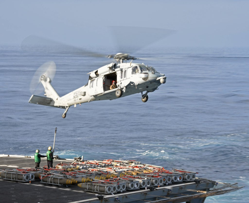 "170218-N-GI441-098 MEDITERRANEAN SEA (Feb. 18, 2017) An MH-60S Sea Hawk helicopter attached to the ""Tridents"" of Helicopter Sea Combat Squadron (HSC) 9 picks up cargo from the fast combat support ship USNS Supply (T-AOE 6) during a replenishment-at-sea. The George H.W. Bush Carrier Strike Group is conducting naval operations in the U.S. 6th Fleet area of operations in support of U.S. national security interests. (U.S. Navy photo by Mass Communication Specialist 3rd Class Brianna Bowens/Released)"