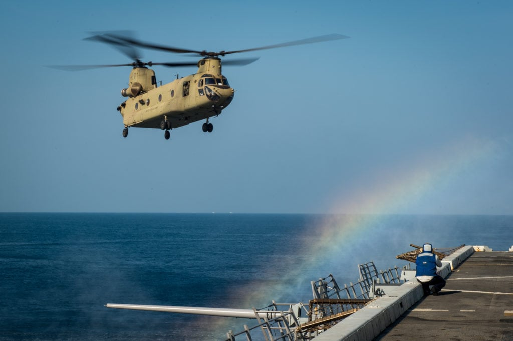 U.S. Navy Mass Communication Specialst 1st Class Chris Williamson photographs a U.S. Army CH-47F helicopter as it lands on the amphibious dock transport ship USS Green Bay (LPD-20) during exercise Cobra Gold off the coast of Thailand, Feb 21, 2017. Cobra Gold is the largest theater security cooperation exercise in the Indo-Asia-Pacific region and is an integral part of the U.S. commitment to strengthen engagement in the region. (U.S. Navy photo by Mass Communication Specialist 2nd Class Chad M. Butler