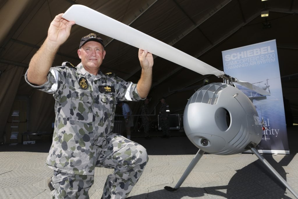 Engineering Manager with the Navy Unmanned Aircraft Systems Unit, Lieutenant Commander Matt Hyam inspects the Schiebel Camcopter S100 Unmanned air System on display at the Australian International Airshow at Avalon. *** Local Caption *** The Australian Defence Force is proud to be part of the 2017 Australian International Airshow, with displays showcasing the latest military aviation assets and technology.