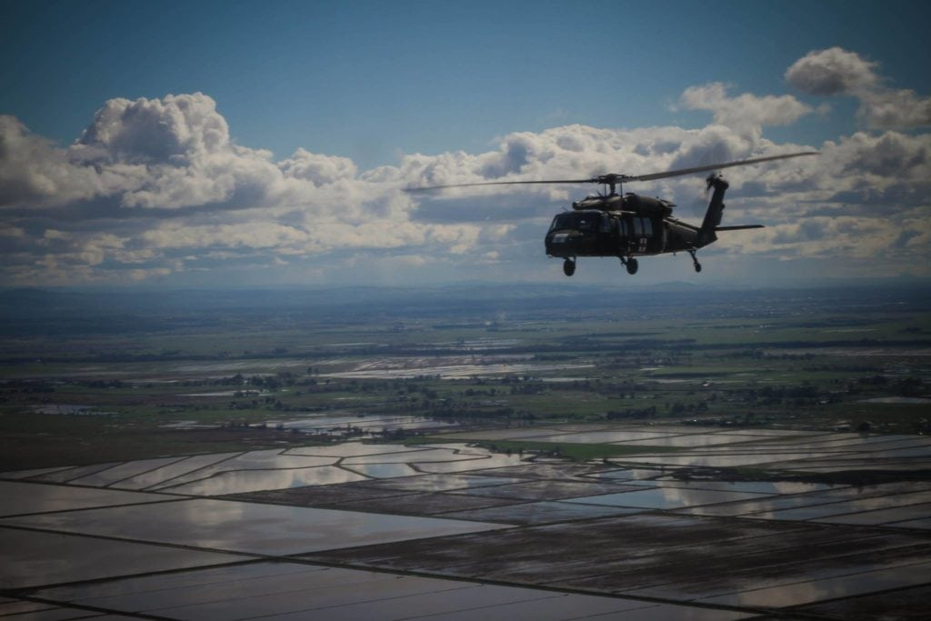 U.S. Soldiers with the California Army National Guard (CAARNG) conduct aerial flood damage assessment from a UH-60 Black Hawk helicopter in Oroville, Calif., Feb. 25, 2017. The CAARNG and federal agencies assisted state officials and local residents in the aftermath of a dam failure near Oroville, California, resulting from record precipitation over several months. (U.S. Army National Guard photo)