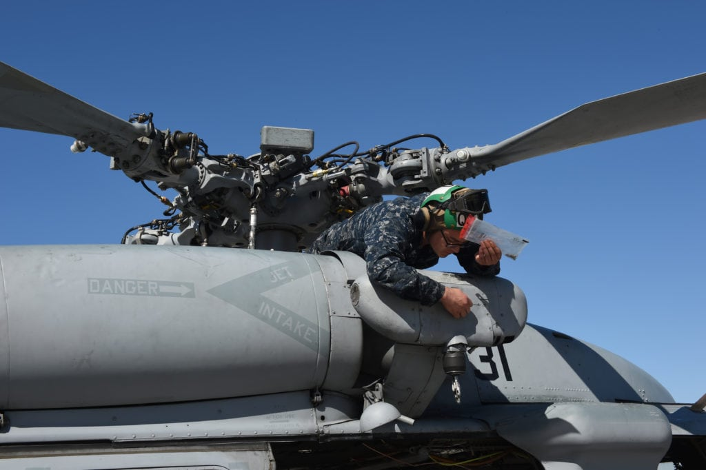 170311-N-OS584-011 SAN DIEGO (Mar. 11, 2017) Aviation Structural Mechanic 3rd Class Taylor Adam of Helicopter Squadron Combat 3 is completing final maintenance on an MH60-S helicopter on the flightline at Naval Air Station North Island, Coronado, Calif. (U.S. Navy photo by Mass Communication Specialist 1st Class Jimmie Crockett/Released).