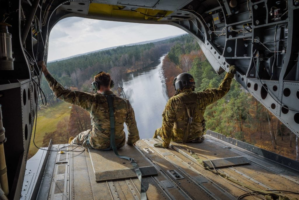 U.S. Soldiers assigned to 1st Battalion, 3rd Aviation Regiment (Attack Reconnaissance Battalion), 12th Combat Aviation Brigade, observe the 7th Army Training Command's Grafenwoehr Training Area from the tailgate of a CH-47F Chinook during maneuvers training exercise, Germany, March 15, 2017. (U.S. Army photo by Spc. Nathanael Mercado)