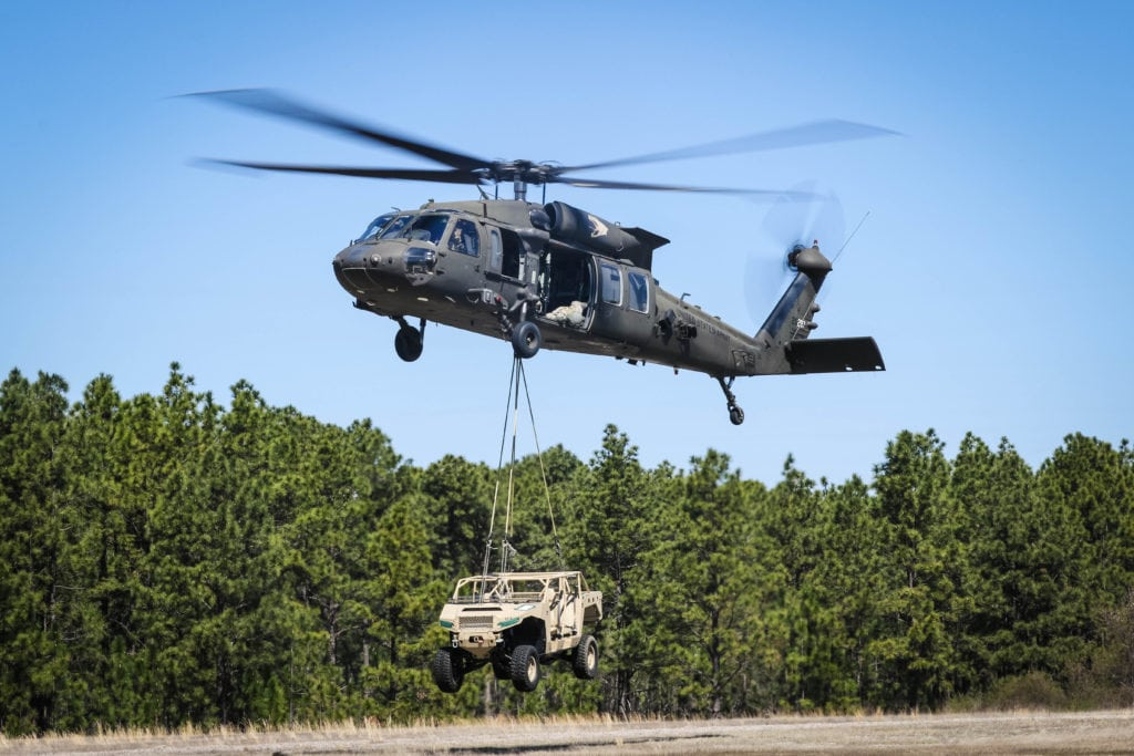 A UH-60 Black Hawk helicopter assigned to the 2nd Assault Helicopter Battalion, 82nd Combat Aviation Brigade, lifts a polaris dagor in support of the XVIII Airborne Corps' DeGlopper Air Assault School on Fort Bragg, N.C., Mar. 23, 2017. (U.S. Photo by Capt. Adan Cazarez)