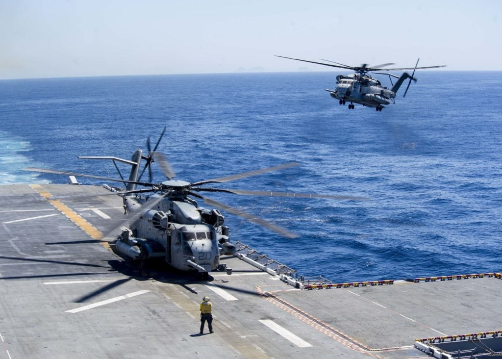 170329-N-ZQ712-0067 PACIFIC OCEAN ( March 29, 2017) A CH-53E Super Stallion helicopter assigned to Marine Medium Tiltrotor Squadron (VMM) 161 (Reinforced) prepares to land on the flight deck of the amphibious assault ship USS America (LHA 6). The ship is underway conducting amphibious squadron and Marine expeditionary unit integration operations in preparation for a deployment. (U.S. Navy photo by Mass Communication Specialist Seaman Apprentice Chad Swysgood/Released)