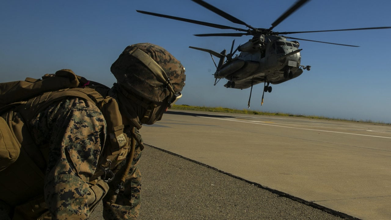 MARINE CORPS BASE CAMP PENDLETON, Calif. – Lance Cpl. Kieran Hayes a landing support specialist with Combat Logistics Battalion 15, 15th Marine Expeditionary Unit waits for a CH-53E Super Stallion helicopter to get in position to conduct helicopter support team mission during PHIBRON-MEU integration training at Camp Pendleton, April 13, 2017. The CH-53E Super Stallion makes the MEU that much more capable as it is able to move personnel, equipment, and vehicles from ship to shore, demonstrating the 15th MEU's ship-to-shore connector capabilities. PMINT lays the foundation for all the elements of the MEU to develop relationships with their Navy counterparts and gain an understanding of the teamwork required to accomplish the mission. (U.S. Marine Corps photo by Cpl. Frank Cordoba)