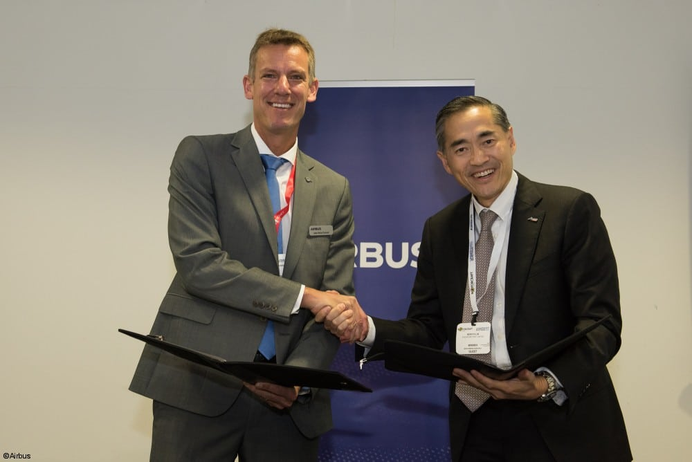 Jean-Brice Dumont, Airbus Helicopters' EVP of Engineering and CTO, and Mervyn Lim, SingPost's Covering Group CEO, sign an MoU for Skyways at Rotorcraft Asia. Photo courtesy of Airbus