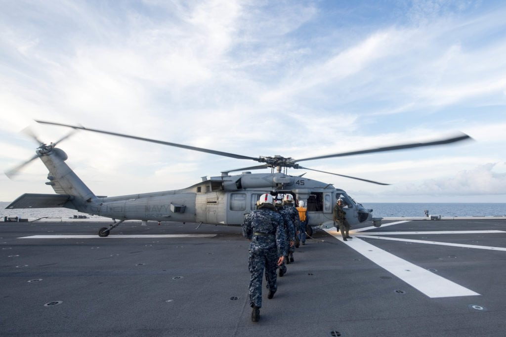 170518-N-PD309-322 SOUTH CHINA SEA (May 18, 2017) Sailors assigned to littoral combat ship USS Coronado (LCS 4) prepare to board an MH-60S Seahawk helicopter back to Coronado after completing a personnel exchange and tour aboard Japanese Maritime Self Defense Force ship JS Izumo (DDH 183) as part of a bilateral passing exercise at sea. Coronado is on a rotational deployment in U.S. 7th Fleet area of responsibility, patrolling the region's littorals and working hull-to-hull with partner navies to provide 7th Fleet with the flexible capabilities it needs now and in the future. (U.S. Navy photo by Mass Communication Specialist 3rd Class Deven Leigh Ellis/Released)