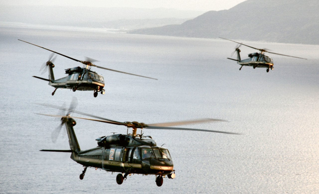 A group CBP UH-60 Blackhawk helicopters on patrol over the Carribean.