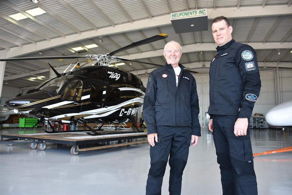 Father and son duo Bob and Steven Dengler in front of the Bell 429 helicopter they'll be piloting during their journey as the world's first Canadian helicopter flight around the world. Photo courtesy of C150GO, Honeywell