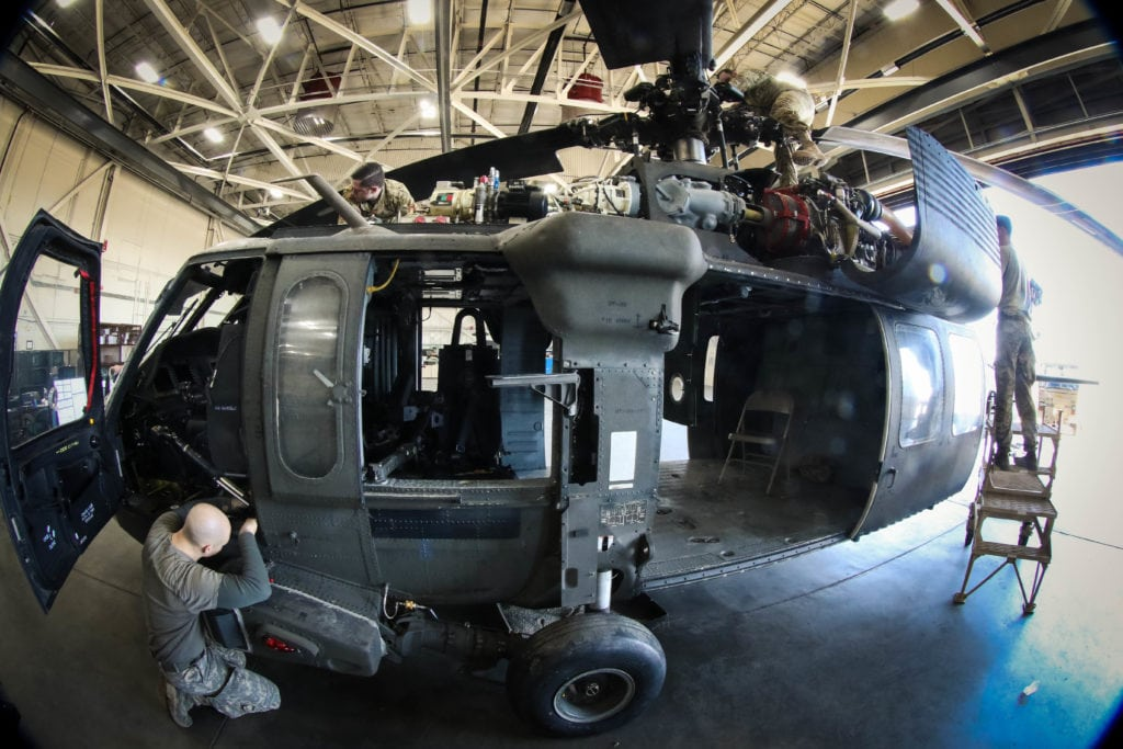 Maintainers assigned to the 122nd Aviation Support Battalion work to install equipment on a UH-60 Black Hawk assigned to 82nd Combat Aviation Brigade at Fort Bragg, N.C. Nov 16. (U.S. Army photo by Sgt. Steven Galimore)