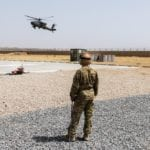 A U.S. Army Soldier assigned to Task Force Griffin, 16th Combat Aviation Brigade, 7th Infantry Division waits for an AH-64E Apache helicopter to land for refueling and rearming in Kunduz, Afghanistan, May 31, 2017. The Griffins are working hard to support U.S. Forces Afghanistan as part of Operation Freedom's Sentinel and Resolute Support Mission.