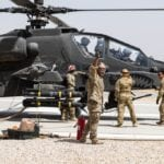A U.S. Army Soldier assigned to Task Force Griffin, 16th Combat Aviation Brigade, 7th Infantry Division signals to start fuel flow during refueling of an AH-64E Apache helicopter in Kunduz, Afghanistan, May 31, 2017. The Griffins are working hard to support U.S. Forces Afghanistan as part of Operation Freedom's Sentinel and Resolute Support Mission.