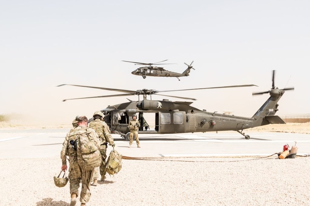 A U.S. Army UH-60 Black Hawk helicopter crew chief assigned to Task Force Griffin, 16th Combat Aviation Brigade, 7th Infantry Division directs passengers during loading in Kunduz, Afghanistan, May 31, 2017. The Griffins are working hard to support U.S. Forces Afghanistan as part of Operation Freedom's Sentinel and Resolute Support Mission.