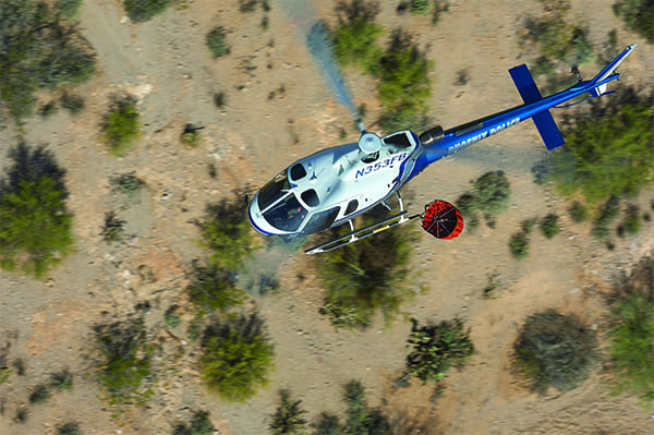 A Phoenix, Arizona, Police Department AS350 trains for wildland firefighting in a desert park east of the city.