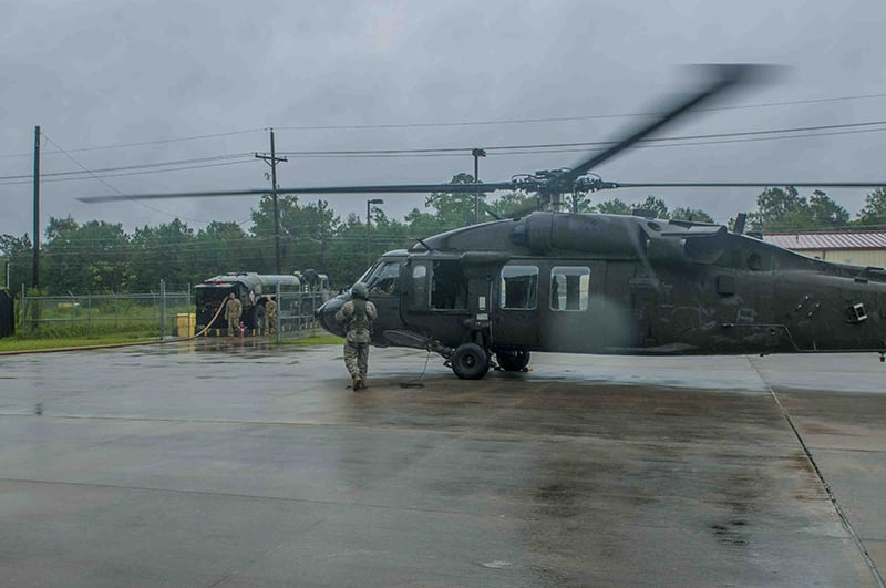 U.S. Army Reserve Soldiers from E Company, 1-158 Assault Helicopter Battalion, prepare to refuel an Army Reserve UH-60 Blackhawk Helicopter support local rescue operations after Hurricane Harvey, Conroe, Texas, August 29, 2017. U.S. Army Reserve Photo by Capt. Loyal Auterson