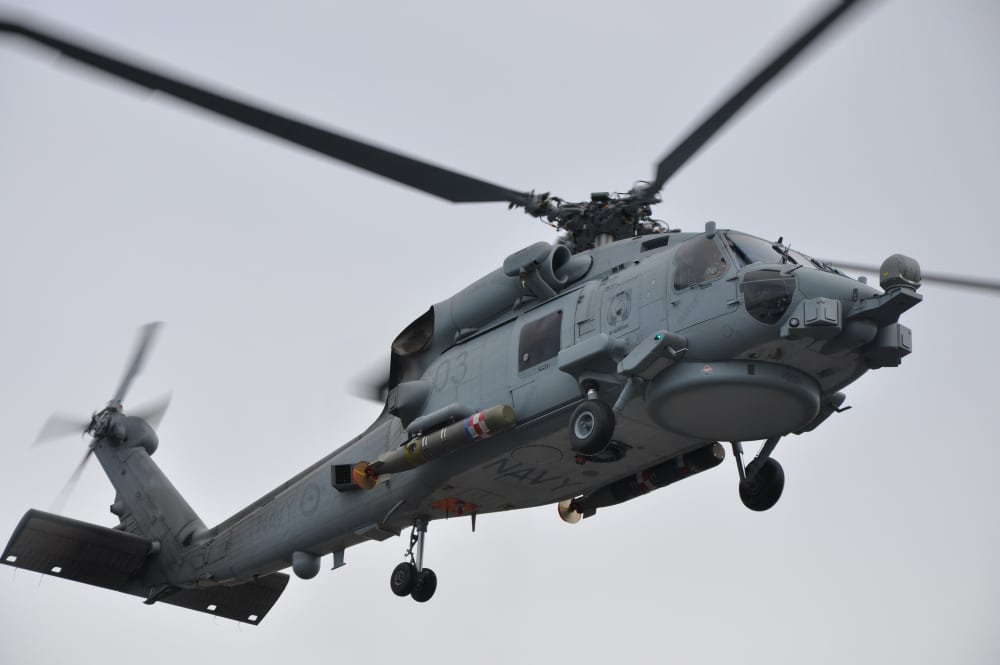 A MH-60R loaded with a Mk 54 torpedo during a firing serial in Florida.