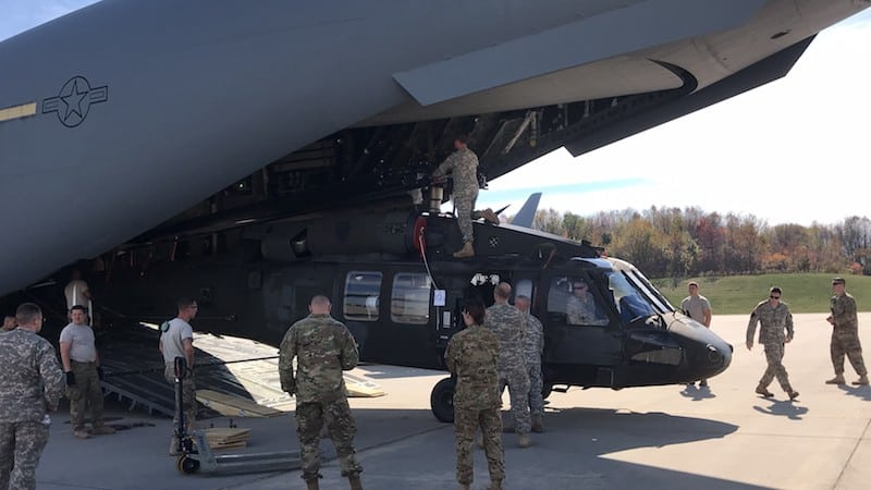 Pennsylvania Army National Guard Soldiers load a UH-60 Black Hawk Helicopter into a C-17 Globemaster III aircraft Oct. 22 at Army Aviation Support Facility in Johnstown, Pa. before departing to the Puerto Rico in support of Hurricane Maria relief operations. (U.S. Army National Guard courtesy photo)