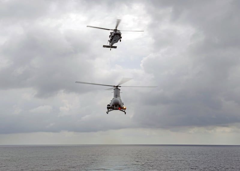 170202-N-WV703-160 SOUTH CHINA SEA (Feb. 02, 2017) An MH-60S Seahawk helicopter, above, and an MQ-8B Fire Scout unmanned helicopter conduct flight operations following launch from littoral combat ship USS Coronado (LCS 4) in the South China Sea. Currently on a rotational deployment in support of the Asia-Pacific Rebalance, Coronado is a fast and agile warship tailor-made to patrol the region's littorals and work hull-to-hull with partner navies, providing 7th Fleet with the flexible capabilities it needs now and in the future. (U.S. Navy photo by Mass Communication Specialist 2nd Class Amy M. Ressler/Released)