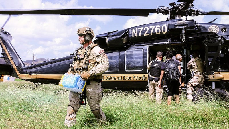 Agents with a U.S. Customs and Border Protection, Air and Marine Operations, Black Hawk crew distribute much-needed supplies to residents of Puerto Rico as they conduct post Hurricane Maria humanitarian operations September 27, 2017. U.S. Customs and Border Protection photo by Rob Brisley