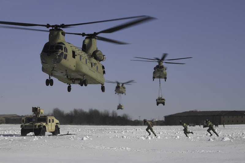 A U.S. Army aircrew assigned to Company B, 6th General Support Aviation Battalion, 101st Combat Aviation Brigade, 101st Airborne Division (Air Assault) position a CH-47 Chinook helicopter above an M1151 high mobility multipurpose wheeled vehicle as 3rd Brigade Combat Team, 101st Abn. Div. Soldiers prepare for sling load operations, Jan. 19, at Fort Campbell. The Soldiers took part in a combined air assault mission to demonstrate and practice their unique capabilities as the world's only air assault division. (Photo Credit: Sgt. 1st Class Andre McClure)