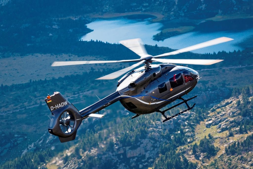 Airbus' new five-bladed H145 flies in the French Pyrenees Mountains.
