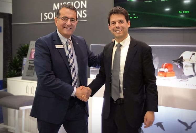 Universal Avionics CEO Paul DeHerrera (left) shakes hands with Dror Yahav (right), who will take over as chief executive for the Elbit Systems subsidiary April 10, 2019.