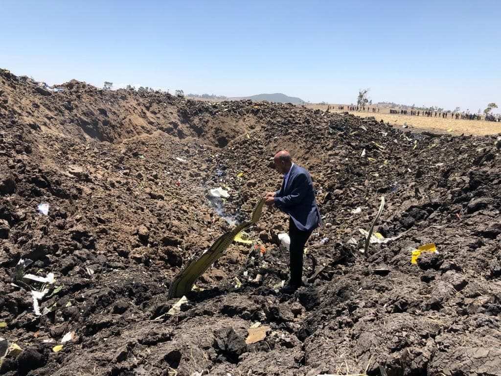Ethiopian Airlines Group CEO Tewolde GebreMariam amid the wreckage of Flight ET 320.