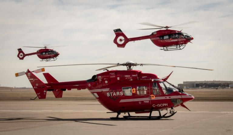 STARS' two new Airbus H145 helicopters fly past one of the providers' BK117s.