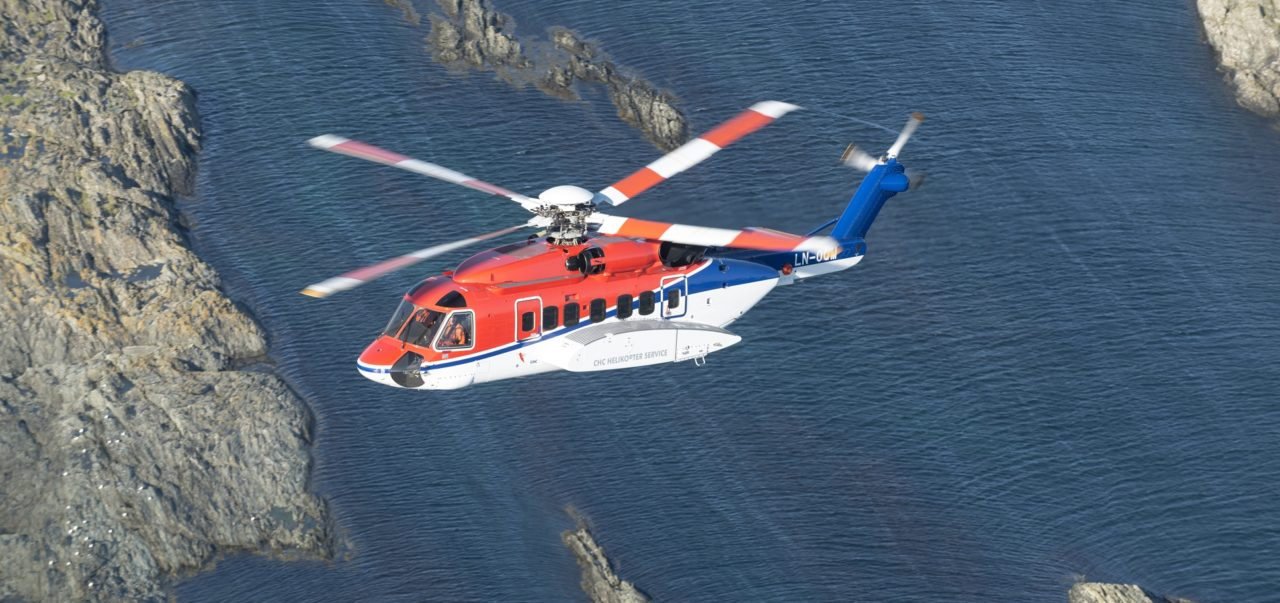 A CHC-owned Sikorsky S-92 flies over Norwegian waters.