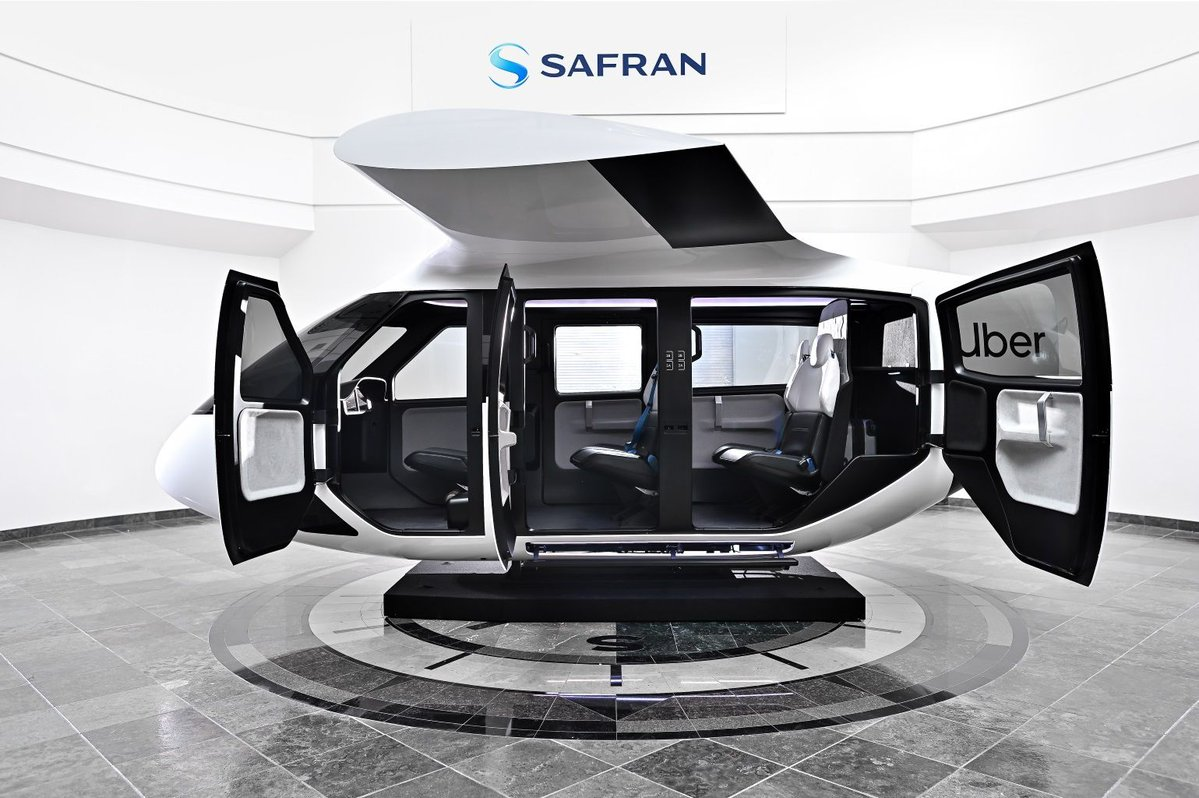 Safran's cabin design for Uber's UAM mission. Note the doors and wing, designed to work together to create an inviting experience to passengers. (Safran)